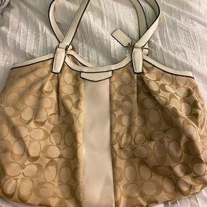 white and tan coach bag